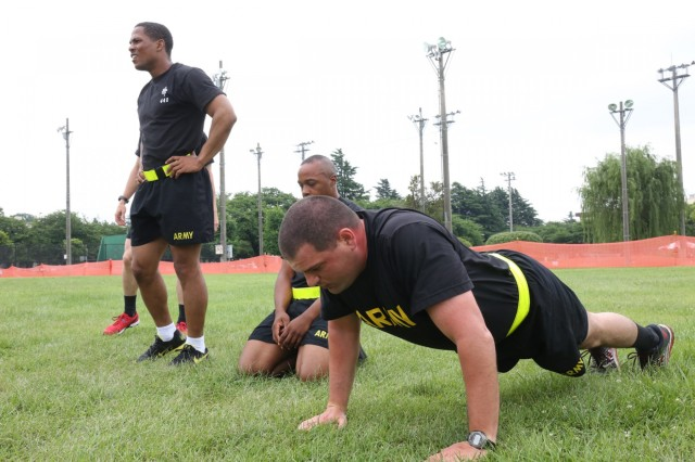 Soldiers assigned to 311th Military Intelligence Battalion participate in Army physical readiness training June 12, 2018 at the Dining Facility Field during Camp Zama's Army Birthday Week celebration. (U.S. Army Photo by Noriko Kudo)