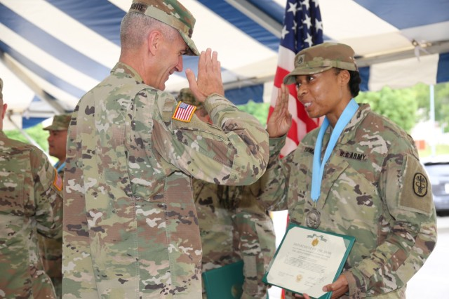 Staff Sgt. April Thomas, assigned to Public Health Activity Japan, salutes Maj. Gen. James F. Pasquarette, commanding general of USARJ after receiving an Audie Murphy induction award June 13, 2018 outside the Camp Zama Community Club for the Army Birthday Week celebration. (U.S. Army Photo by Noriko Kudo)