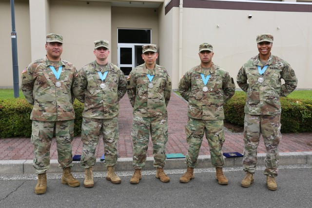 Four Soldiers who were inducted into the Sgt. Audie Murphy Club, receiving an induction award from Maj. Gen. James Pasquarette, commanding general of U.S. Army Japan June 13, 2018 at Camp Zama Community Club during the Army Birthday BBQ are pictured with their outgoing President. From left to right: Staff Sgt. Joel Heredia, U.S. Army Japan Band; Staff Sgt. Michael Jenkins, 35th Combat Sustainment Support Battalion; Sgt. 1st Class Edwin Salazarvaldez, USARJ Headquarters and Headquarters Company, outgoing president of the USARJ Chapter of the SAMC; Staff Sgt. Damien Stowers, 311th Military Intelligence Btn.; and Staff Sgt. April Thomas, Public Health Activity -- Japan, incoming president for the SAMC USARJ Chapter. (U.S. Army photo by Noriko Kudo)