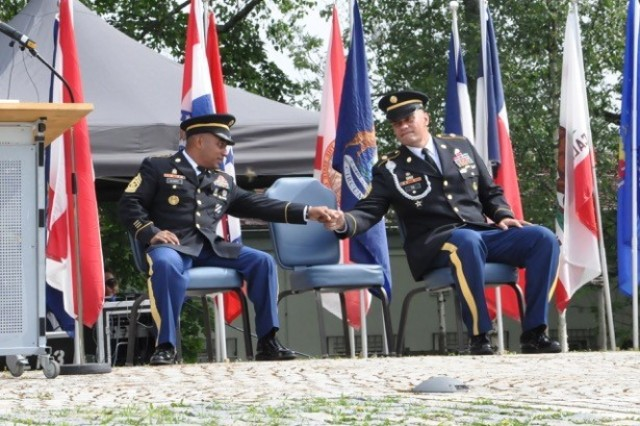 From left, Command Sergeants Major Mariano Z. Alvarez and Toese Tia share a fist bump during the change of responsibility ceremony, June 15.