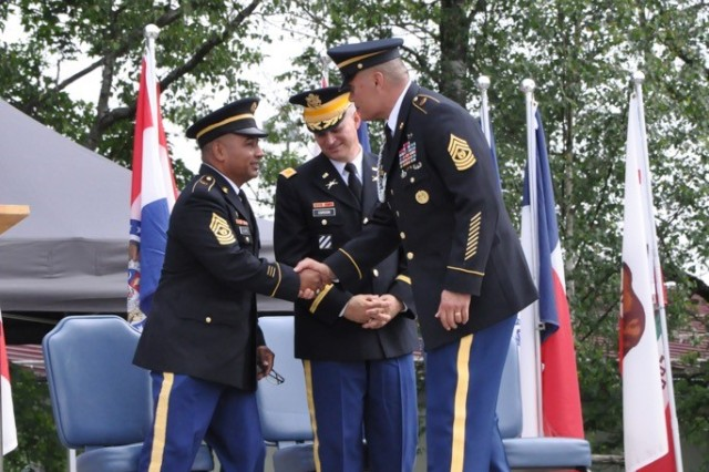 From left, Command Sgt. Maj. Mariano Z. Alvarez, Col. Neal Corson and Command Sgt. Maj. Toese Tia shake hands together.