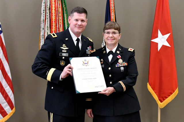 Col. Elaine McGarry receives her certificate of retirement from Brig. Gen. Martin Klein, commanding general of the Deployment Support Command and SDDC deputy commanding general for mobilization.  A U.S. Army reservist, McGarry served 30 years, culminating with her assignment as deputy operations officer at the Military Surface Deployment and Distribution Command (SDDC).