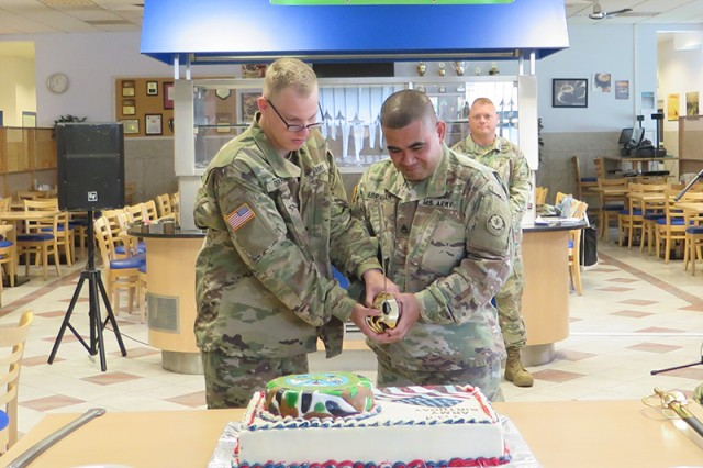 Pvt. Gregory Oxford, left, and Staff Sgt. Steven Abraham, both with 2nd Cavalry Regiment, cut the cake during 243rd Army Birthday celebration June 14, 2018, at the Stryker Inn Dining Facility on Rose Barracks in Vilseck, Germany.