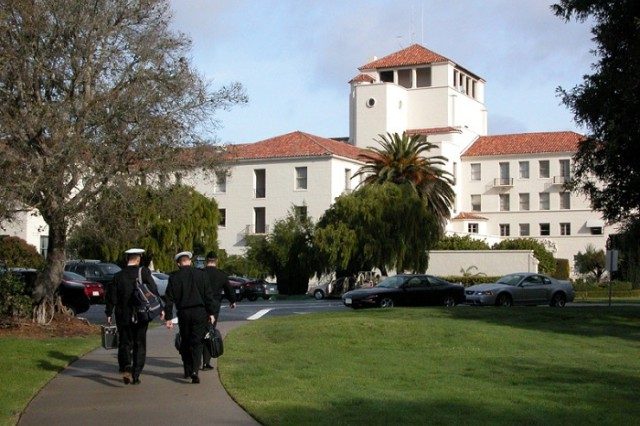 Sailors approach NPS' Herrmann Hall. NPS' new curriculum in systems and program management and in systems engineering management for students from the Army Acquisition Workforce supports its overall mission to provide relevant and unique advanced education and research programs to increase the combat effectiveness of commissioned officers of the Naval Service and thus enhance the security of the United States.