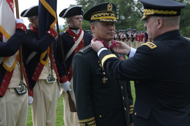 Gen. Young Woo Kim (left), Chief of Staff of the Army, Republic of Korea receives the Legion of Merit from Gen. Mark A. Milley, U.S. Army Chief of Staff during an Army Arrival Ceremony at Whipple Field, Joint Base Myer-Henderson Hall, Va., June 20, 2018. (U.S. Army photo by Cory Hancock, JFHQ-NCR/MDW Public Affairs)