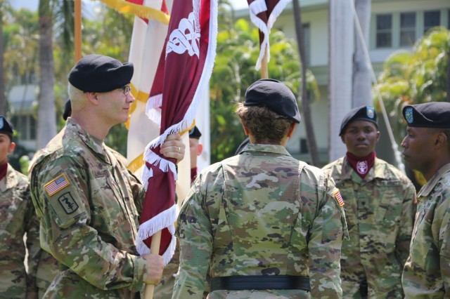 FORT SHAFTER, Hawaii (June 20, 2018) -- Regional Health Command-Pacific (RHC-P) incoming Commanding General, Brig. Gen. Dennis LeMaster (left), accepts the colors from Army Surgeon General and Commanding General, U.S. Army Medical Command, Lt. Gen. Nadja West (center), along with outgoing RHC-P Commander, Brig. Gen. Bertram Providence (right), during the RHC-P change of command ceremony.