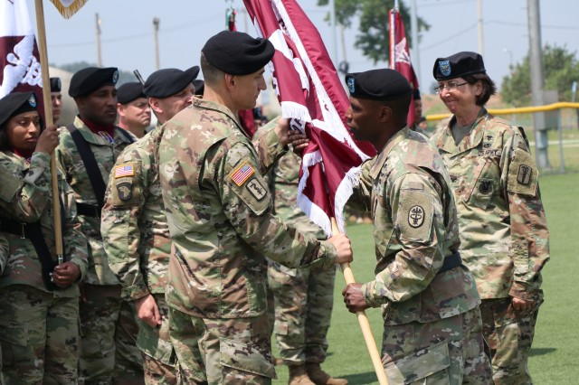Brig. Gen. Bertram Providence, the commanding general of the Regional Health Command-Pacific, passes the U.S. Army Medical Department Activity Korea colors to the incoming commander, Col. Derek C. Cooper, as the outgoing commander, Col. Wendy L. Harter, looks on during the May 31, 2018 change of command ceremony on U.S. Army Garrison Humphreys.