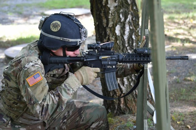 U.S. Army 1st Lt. Robert L. Martin assigned to 1st Battalion, 4th Infantry Regiment, 7th Army Training Command (7th ATC) shoots his M4 carbine during the stress shoot lane as part of the 7th ATC Best Warrior Competition, Grafenwoehr Training Area, Germany, June 20, 2018. The three-day event ends June 21 with the announcement of the 7th ATC Officer, Noncommissioned Officer and Soldier of the Year. The winners will move on to compete in the U.S. Army Europe Best Warrior Competition. (U.S. Army photo by Gertrud Zach)