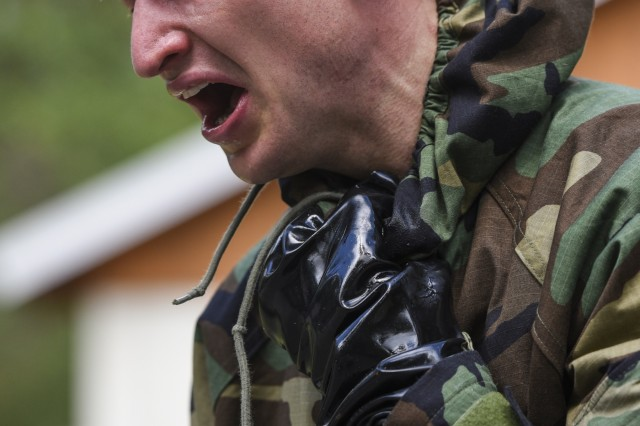 U.S. Army Spc. Derek Teegardin with 1st Battalion, 4th Infantry Regiment, Joint Multinational Readiness Center, 7th Army Training Command (7ATC), feels the effect after exiting the gas chamber during the chemical, biological, radiological and nuclear lane as part of the 7ATC Best Warrior Competition June 20, 2018 at Grafenwoehr Training Area, Germany. Teegardin, a Battle Creek, MI native is competing in the three-day event ending June 21 with the announcement of the 7ATC Officer, Noncommissioned Officer and Soldier of the Year. The winners will move on to compete in the U.S. Army Europe Best Warrior Competition. (U.S. Army photo by Markus Rauchenberger)