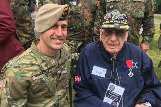 Capt. William Wurzel, a platoon tactical trainer with the 4th Ranger Training Battalion, takes a photo with U.S. veteran of World War II Wesley Athey during the 74th anniversary commemoration of D-Day at Sainte-Mère-Église, France, June 6, 2018. (Courtesy photo)
