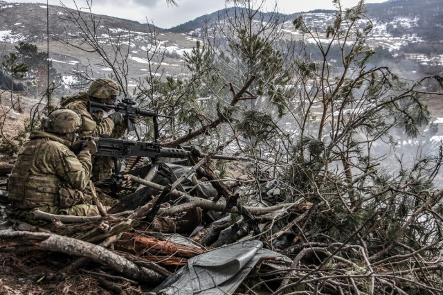 The muzzle blast from a M2 .50 caliber machine gun tears through camouflage as gunners from the 173rd Airborne Brigade Support Battalion conduct base defense training in March in Slovenia. Though the search for a new camouflage pattern was not a major defense acquisition program, it attracted a lot of high-profile interest from Army leadership and Congress, as well as from the Soldiers who would be wearing the new uniform.