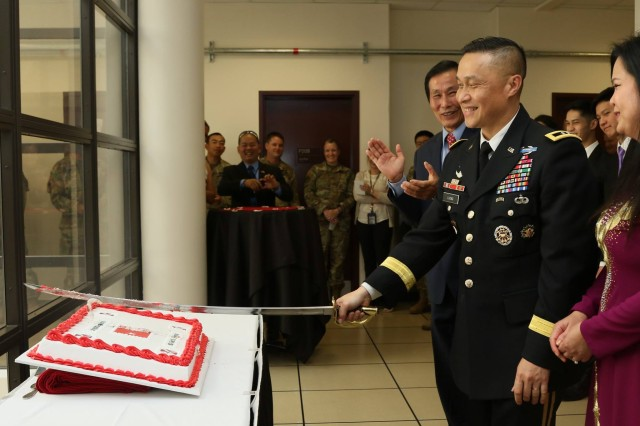 Maj. Gen. Viet X. Luong, Eighth Army deputy commanding general operations, smiles as he cuts the cake at his promotion ceremony at Eighth Army Headquarters, Camp Humphreys, South Korea, June 21st, 2018. His family, friends, fellow service members and members of the community attended the ceremony to celebrate his promotion.