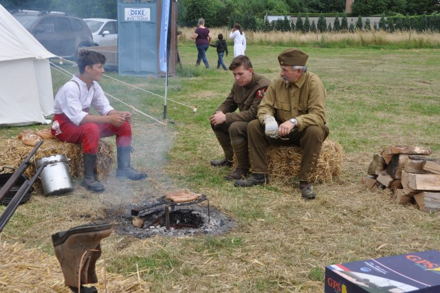 Re-enactors eat sausages in the WWI-themed camp during the American Festival in Chièvres, Belgium, June 17, 2018. The festival brought Americans and Belgians together as they experienced American culture in the local town.