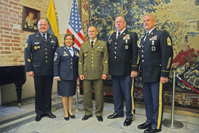 Pennsylvania National Guard and Lithuanian Armed Forces leadership pose during a reception in Vilnius, Lithuania June 9. From left to right: Lithuanian Command Sgt. Maj. Alvydas Tamosius, Lithuanian Air Force CSM, U.S. Air Force Command Chief Master Sgt. Regina Stoltzfus, Pennsylvania Air National Guard command chief, Lithuanian Command Sgt. Maj. Remigijus Katinas, Lithuanian Land Forces CSM, U.S. Army Command Sgt. Maj. Harry Buchanan III, senior enlisted advisor for the Pennsylvania National Guard, and U.S. Army Command Sgt. Maj. Timothy Hileman, Pennsylvania National Guard Joint Force Headquarters.