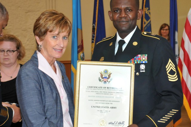 Master Sgt. Felder Benjamin receives his Certificate of Retirement during the RIA Retirement and Retreat Ceremony, June 21.