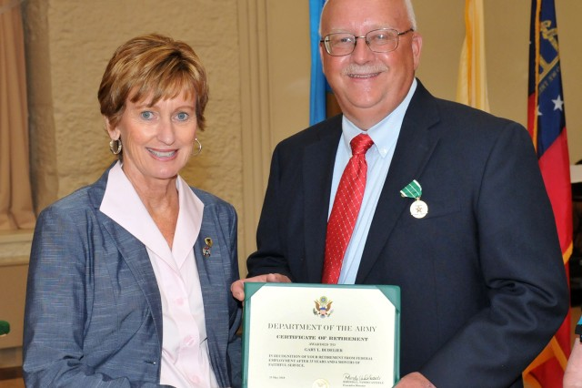 Mr. Gary Budelier receives his Certificate of Retirement during the RIA Retirement and Retreat Ceremony, June 21.