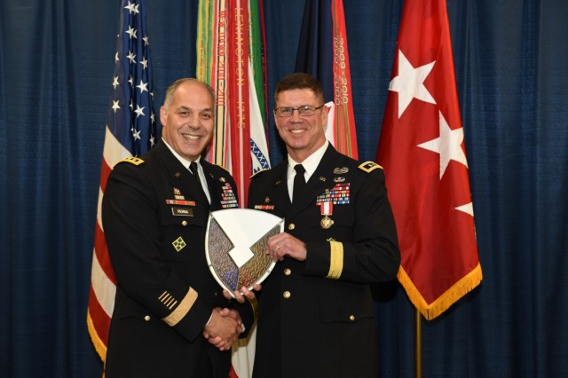 The Army Materiel Command workforce says goodbye to Maj. Gen. Daniel G. Mitchell, deputy chief of staff for logistics and operations, during a June 22 award ceremony. AMC's commander Gen. Gus Perna presented Mitchell with the Distinguished Service Medal. (U.S. Army photo by Douglas Brewster)