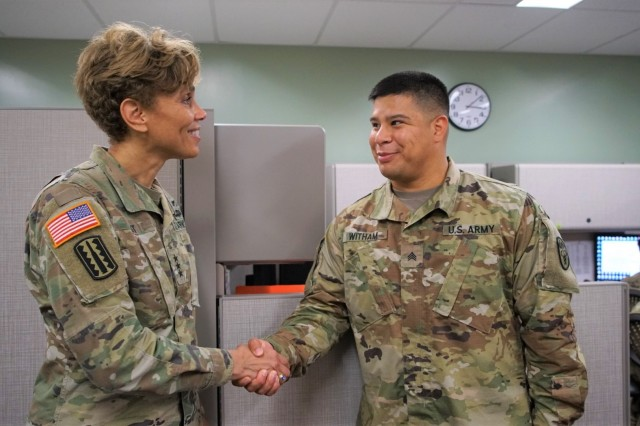 HONOLULU, Hawaii (June 21, 2018) -- The Army Surgeon General and U.S. Army Medical Command (MEDCOM) Commanding General, Lt. Gen. Nadja West, presents a coin to Sgt. Michael Witham, Dental Health Command-Pacific (DHC-P) Soldier during a visit to the DHC-P headquarters. (Photo credit: Sgt. Vonyda Ayala)