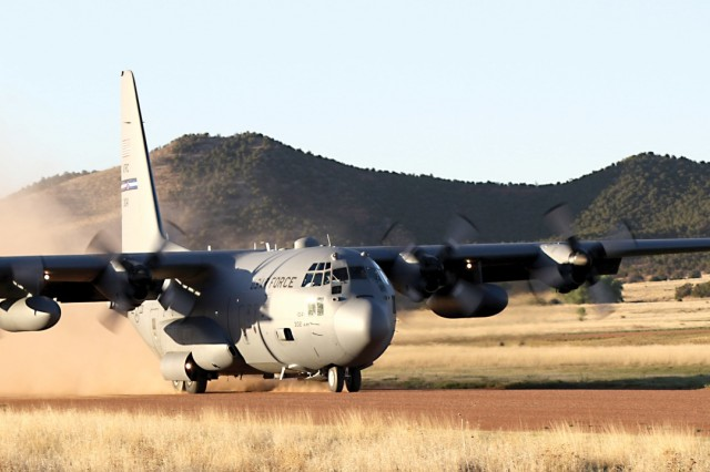 Air Force Lt. Col. Richard Pantusa, 731st Airlift Squadron, lands a C-130 aircraft for the timed release of equipment recently before taking flight again as part of an emergency deployment readiness exercise conducted by 2nd Infantry Brigade Combat Team, 4th Infantry Division. (Photo by 2nd Lt. Angie DiMattia)