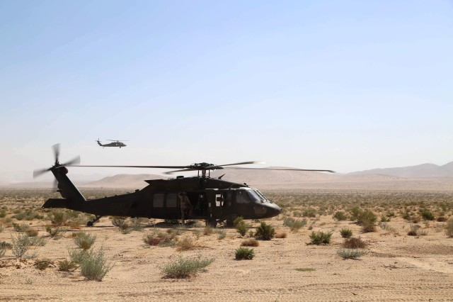 U.S. Army Soldiers assigned to 2nd Brigade Combat Team, 2nd Infantry Division prepare to execute a simulated medical evacuation in a UH-60 Blackhawk during Decisive Action Rotation 17-09 at the National Training Center in Fort Irwin, Calif., Sep. 17, 2017. Soldiers with 8th Squadron, 1st Cavalry Regiment, 2nd Brigade Combat Team, 2nd Infantry Division recently completed joint training with airmen in June 2018 at Joint Base Lewis-McChord, Wash., on quickly transporting troops and equipment from Washington to California.