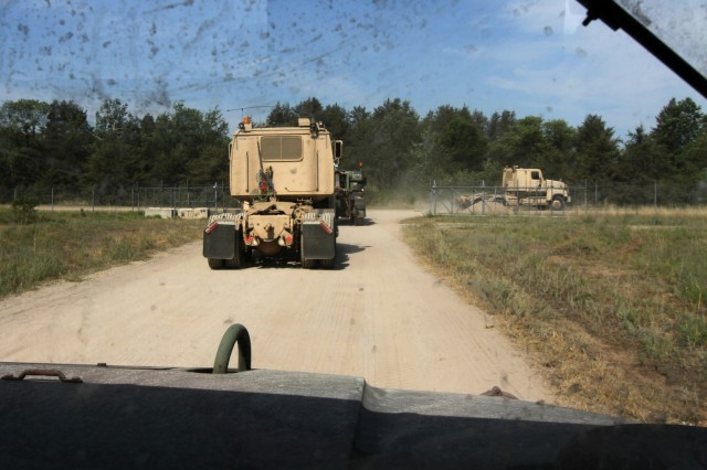 Soldiers of the 1487th Transportation Company, 1483rd Transportation Company and 211th Maintenance Company head off on their tactical convoy operations training June 21, 2018 at the Camp Grayling Joint Maneuver Training Center in Grayling, Mich.