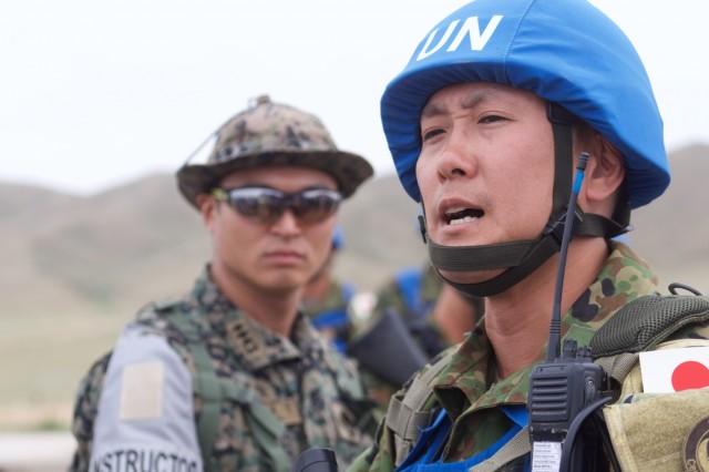 Japan Ground Self-Defense Force 2nd Lt. Seiga Kudo commands his platoon under the watch of multi-national instructors June 21, 2018, at Five Hills Training Area, Mongolia, during a Khaan Quest 2018 patrolling lane. The purpose of Khaan Quest is to gain United Nations training and certification for the participants through the conduct of realistic peace support operations, to include increasing and improving U.N. peacekeeping interoperability and military relationships among the participating nations.