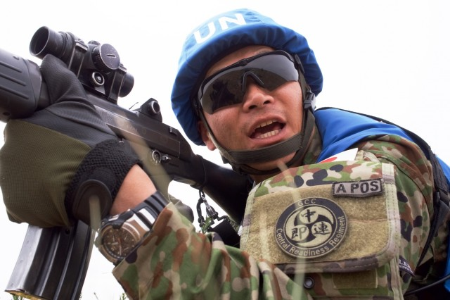 Japan Ground Self-Defense Force Sgt. 1st Class Junya Sawada calls out commands while his unit engages a simulated rebel June 21, 2018, at Five Hills Training Area, Mongolia, during a Khaan Quest 2018 patrolling lane. The purpose of Khaan Quest is to gain United Nations training and certification for the participants through the conduct of realistic peace support operations, to include increasing and improving U.N. peacekeeping interoperability and military relationships among the participating nations.