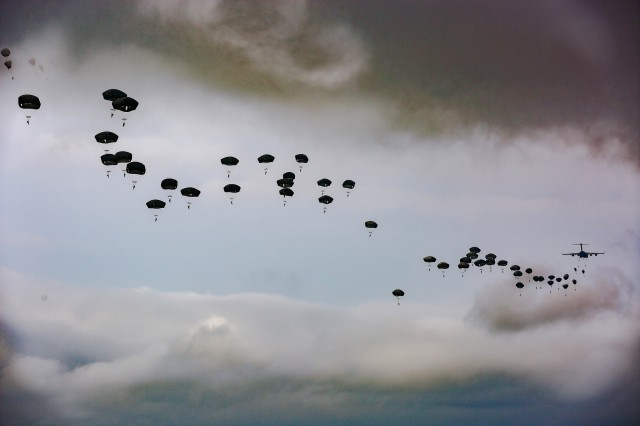 "U.S. Paratroopers assigned to the 82nd Airborne Division participate in the 82nd Airborne Division Airborne Review during All American Week XXIX May 24, 2018, at Fort Bragg, North Carolina. Paratroopers past and present converged on Fort Bragg to celebrate being members of the ""All American"" Division and America's Guard of Honor."
