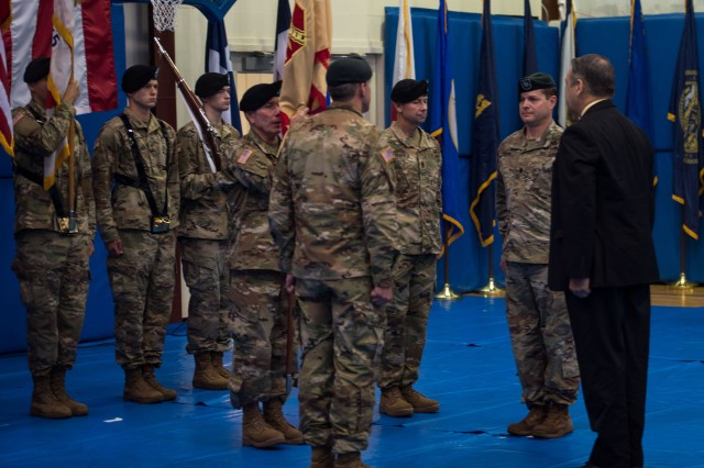 Lt. Col. Michael E. Gates and Command Sgt. Maj. Joseph E. Reilly participate in a change of command, change of responsibility ceremony, in Ambrose Fitness Center, on Fort A.P. Hill, Va., June 22, 2018. During the ceremony, Gates assumes command of the U.S. Army Garrison at Fort A.P. Hill from Lt. Col. Andrew Q. Jordan, while Reilly assumed responsibility as the garrison's senior enlisted advisor from Command Sgt. Maj. Robert L. Parker II. Davis D. Tindoll, Jr., director, Sustainment Directorate, U.S. Army Installation Management Command, officiated at the ceremony. (U.S. Army photo by Sgt. Nicholas T. Holmes)