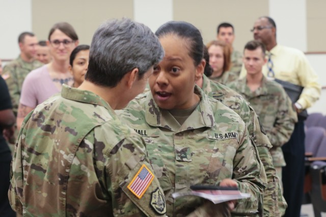 FORT BENNING, Ga. (June 25, 2018) - Col. Karen J. Roe, the 21st Signal Brigade commander, talks to audience members following the Maneuver Center of Excellence and Fort Benning LGBT Pride Month observance. The Maneuver Center of Excellence and Fort Benning held the observation of Lesbian, Gay, Bisexual and Transgender Pride Month at Fort Benning, Georgia, June 21. (U.S. Army photo by Markeith Horace, Maneuver Center of Excellence, Fort Benning Public Affairs)