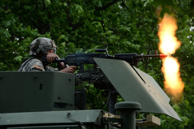 U.S. Army Pvt. Anthony Balac, assigned to the 2nd Platoon, 206th Military Police Company, New York Army National Guard, fires an M240B machine gun June 14, 2018, at Fort Drum, New York. Balac and his team came under simulated fire while providing support for Soldiers of 3rd Platoon who were conducting base security training.