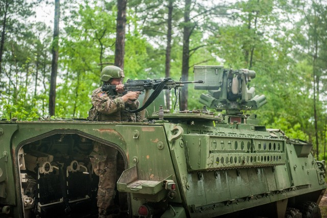A U.S. Army Infantry Soldier-in-training assigned to Alpha Company, 1st Battalion, 19th Infantry Regiment, 198th Infantry Brigade, engages the opposing force (OPFOR) May 2, 2017, with a M249 Squad Automatic Weapon (SAW) on a Stryker to provide support-by-fire during a squad training exercise, Fort Benning, Ga. In 2019, the Army will extend one-station unit training for Infantry Soldiers from 14 weeks to 22 weeks.