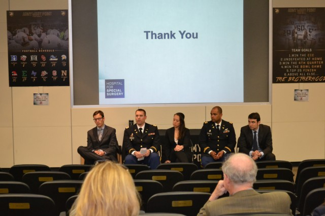Maj. Dana Hensley (2nd from left) answers questions, in relation to his research, from the assembled audience which includes sports medicine fellows, attending physicians, and orthopedic specialists.Sitting with Hensley are fellows (from l-r) Dr. Joel Huleatt, Univ. of Connecticut Health Center (UCHC); Dr. Laura A. Vogel-Abernathie, UCHC; Maj. Ronald Goodlett, MD, Keller Army Community Hospital; and Dr. Ivan De Martino, Hospital for Special Surgery.