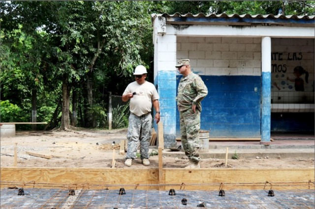 Beyond the Horizon 2018 Sgt. Maj. Jeffrey Topping discusses construction details with U.S. Soldier at one of the new school sites in La Paz, El Salvador on June 2. BTH 2018 is a humanitarian training mission between the Government of El Salvador and the U.S. Embassy El Salvador, together with U.S. Southern command to conduct five medical exercises and five construction projects over a three month period in El Salvador.