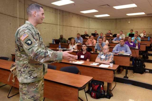 Maj. Justin Toole, U.S. Army Corps of Engineers Nashville District deputy commander, encourages 36 participants of the Hydropower Acquisition Course June 19, 2018 at Tennessee State University's Avon Williams Campus in Nashville, Tenn., to network and freely share expertise.  The purpose of the course is to synchronize best practices and work on improving how the Corps of Engineers executes a hydropower project from cradle to grave. (USACE Photo by Leon Roberts)
