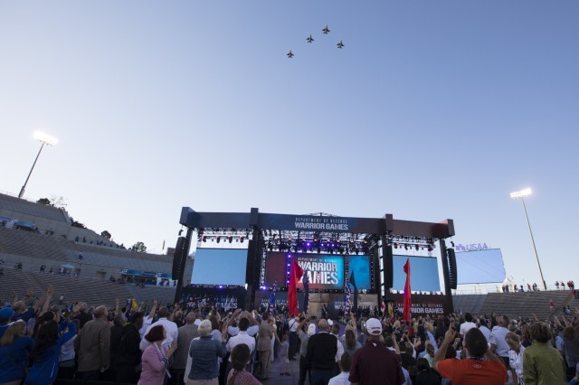 Air Force flyover following performance of the national anthems by members of the 4th Infantry Division Band and Air Force Band during the Opening ceremony of the Warrior Games 2018, at the Air Force Academy, Colorado Springs, Colorado, June 2, 2018. Athletes compete during the Warrior Games against wounded, ill and injured service members and veterans representing the U.S. Army, Marine Corps, Navy, and Special Operations Command, as well as athletes from the U.K. Armed Forces, Australian Defence Force and Canadian Armed Forces. (U.S. Army photo by Sgt. Micah Merrill)