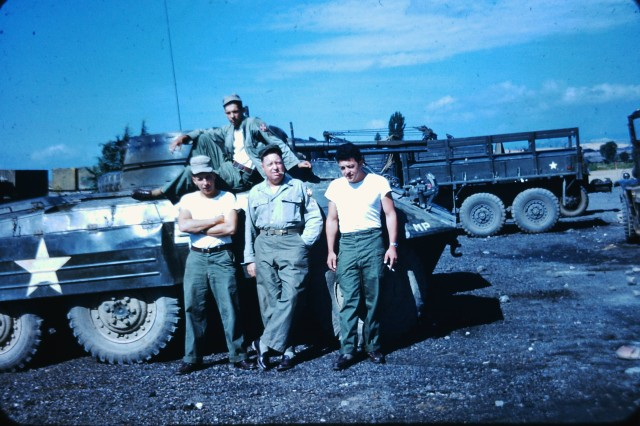 Master Sgt. Thomas Benton Hutton (center) poses with other service members in front of a military vehicle in South Korea during the Korea War circa 1952.  Hutton collected hundreds of photos from his time in Korea, which were donated to the Republic of Korea army by Hutton's grandson, Col. Brandon D. Newton who until the beginning of June, served two years as commander of U.S. Army Garrison Red Cloud and Area I.