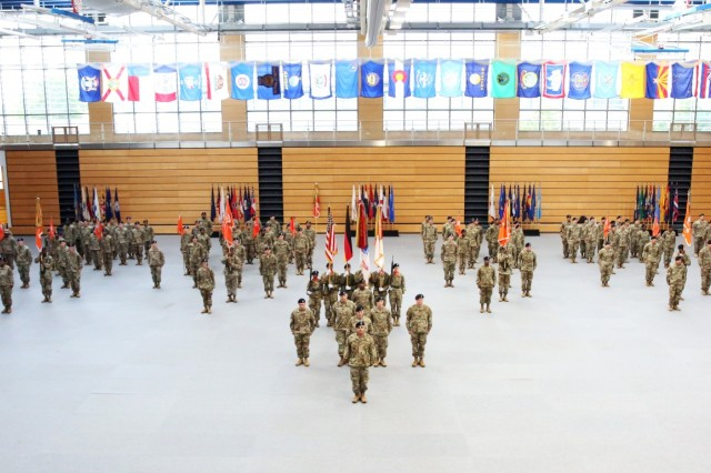 U.S. Army Col. Neil Khatod, commander of 2d Theater Signal Brigade, stands in front of the brigade formation ahead of his assumption of command ceremony June 26, 2018 in Wiesbaden, Germany.