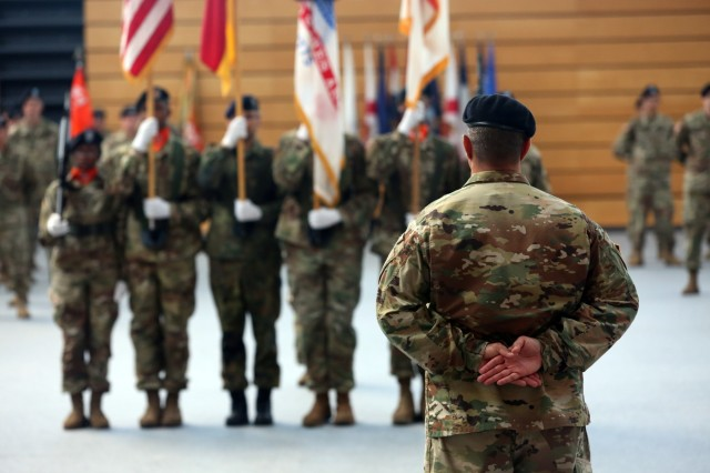 U.S. Army Col. Neil Khatod, commander of 2d Theater Signal Brigade, stands in front of the brigade formation and waits to give remarks during his assumption of command ceremony June 26, 2018 in Wiesbaden, Germany.