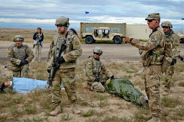 A First Army observer coach/trainer (second from right) makes a point as members of the Idaho Army National Guard's 116th Calvary Brigade Combat Team tend to notional casualties during an Exportable Combat Training Capability exercise at Orchard Combat Training Center, Idaho.