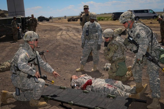 With a First Army observer coach/trainer looking on, members of the Idaho Army National Guard's 116th Calvary Brigade Combat Team tend to a notional casualty during an Exportable Combat Training Capability exercise at Orchard Combat Training Center, Idaho.