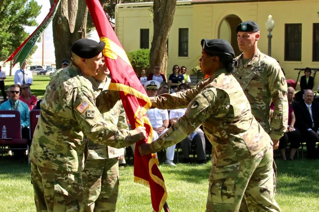 Lt. Col. Scott Bishop, outgoing Hawthorne Army Depot commander, receives the colors from Sgt. Maj. Shontina M. Edwards, Joint Munitions Command Operations Sergeant Major, during the Hawthorne Army Depot Change of Command Ceremony.  (Photo by Victor Trujillo of S.O.C.)