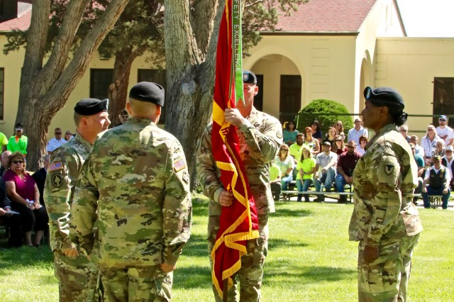 Incoming commander Lt. Col. Dustin G. Bishop holds the Hawthorne Army Depot colors during the Hawthorne Change of Command Ceremony, June 20. (Photo by Victor Trujillo of S.O.C.)