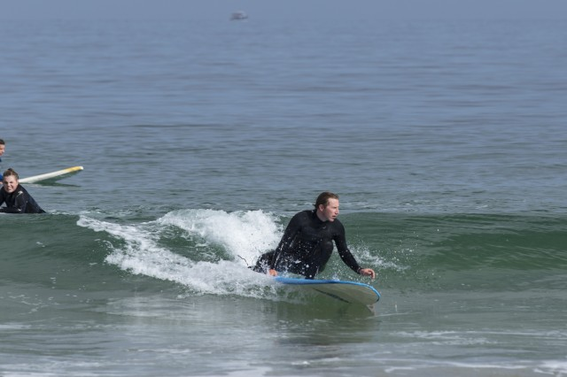 Matthew Paruolo demonstrates surfing techniques to students at Del Monte Beach April 28.