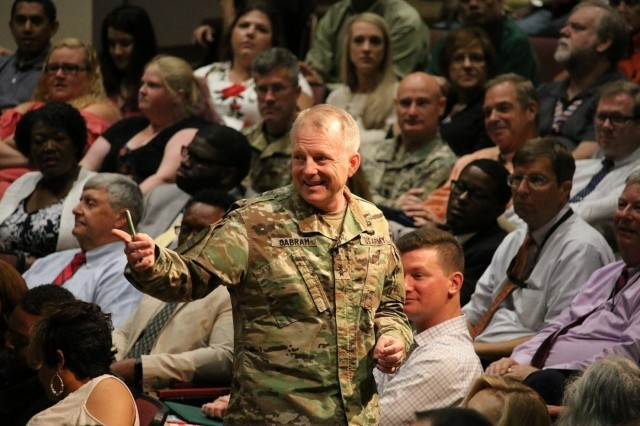 Maj. Gen. Doug Gabram, commander of the Aviation and Missile Command, keeps the mood light during his town hall Thursday with the AMCOM workforce. He highlighted recent accomplishments and upcoming leadership changes. Photo by Julie Frederick