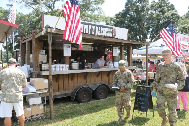 FORT BENNING, Ga. (June 26, 2018) - Soldiers stop for something to eat at Fort Benning's Independence Day celebration. The Maneuver Center of Excellence and Fort Benning opened its gates to the community June 23, 2018, in celebration of the Independence of the United States. (U.S. Army Photo by Markeith Horace, Maneuver Center of Excellence, Fort Benning Public Affairs)
