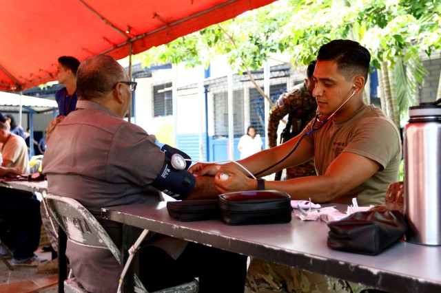 A combat medic attached to Combined Joint Task Force -- Hope, checks for vital signs on a local national during a Medical Readiness Training Exercise in Canton Espino Abajo as part of Beyond the Horizon 2018,  May 28. Beyond the Horizon 2018 is a combined readiness exercise between U.S. Southern Command and El Salvador which provides medical campaigns and construction projects for several communities throughout La Paz Department in the Central American country.