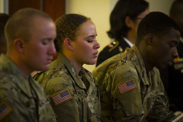 A U.S. Army Soldier, assigned to 643rd Engineer Support, 11th Engineer Battalion, 2nd Combat Aviation Brigade, 2nd Infantry Division, pays her respects to a fallen Soldier during a memorial ceremony on Camp Humphreys, South Korea, May 30. The ceremony was held for Sgt. Mohammed Abdulrahaman, who passed away from renal cancer, leaving behind his wife, Nimatu Abukari, and their two young sons, Naik and Fariq. (U.S. Army photo by Spc. Adeline Witherspoon 20th Public Affairs Detachment)