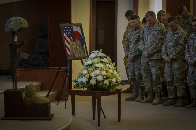 U.S. Army Soldiers, assigned to 643rd Engineer Support, 11th Engineer Battalion, 2nd Combat Aviation Brigade, 2nd Infantry Division, pay their respects to a fallen Soldier on Camp Humphreys, South Korea, May 30. Sgt. Mohammed Abdulrahaman was diagnosed with stage IV renal cancer and is survived by his wife, Nimatu Abukari, and their two young sons, Naik and Fariq. (U.S. Army photo by Spc. Adeline Witherspoon 20th Public Affairs Detachment)