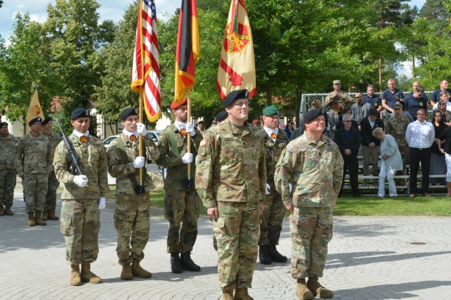 From left, new garrison commander, Col. Adam J. Boyd, and Command Sgt. Maj. Micheal D. Sutterfield represent U.S. Army Garrison Bavaria command. Boyd assumed command of USAG Bavaria here at a ceremony June 27.